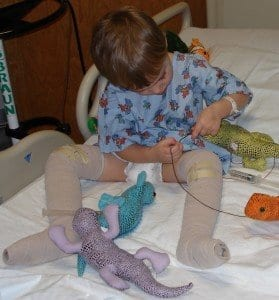 Heather Ferguson's son Dylan, who has primary lymphedema, playing doctor with his stuffed animals during a three-week hospital stay for a cellulitis infection.